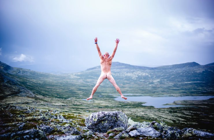 nude ecosexual man jumping